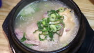 Korean style ginseng chicken soup food. Whole chicken with sticky rice stuffed inside video