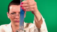 Lab worker with test tubes video