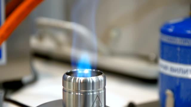 Laboratory gas burner blue flame video