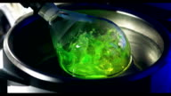 Laboratory glass with liquid in Slow Motion video