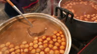 Ladle fish meatball curry for serving ,Bangkok , Thailand. video