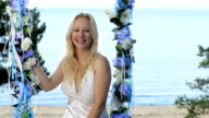 Lady, decorated swings and beautiful sea side video