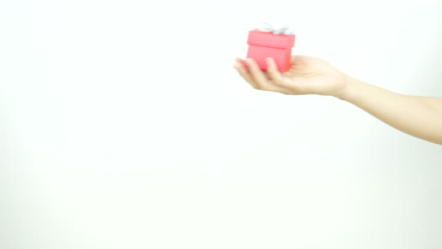 A lady gives a man a gift box on Valentine's Day. video