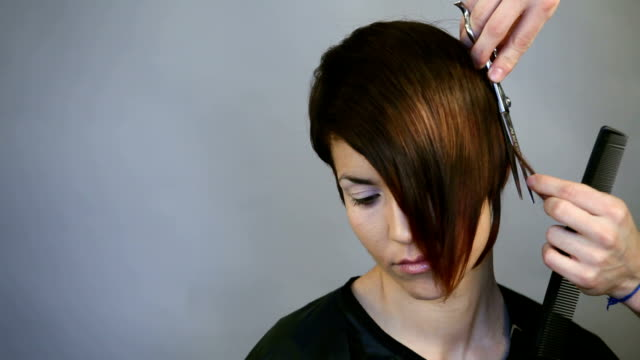 Lady having her hair cut Full HD video