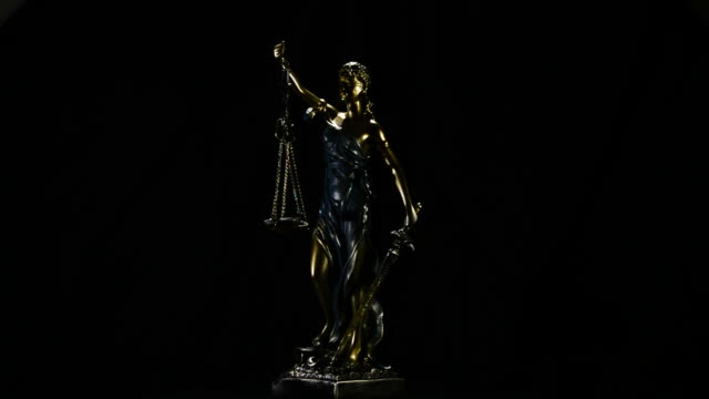 Lady Justice image gyrating on black background video