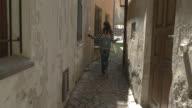 Lady walks between buildings. video
