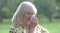 Lady wiping eyes with handkerchief. video