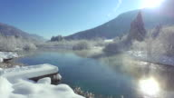 AERIAL: Lake in beautiful wintry landscape video
