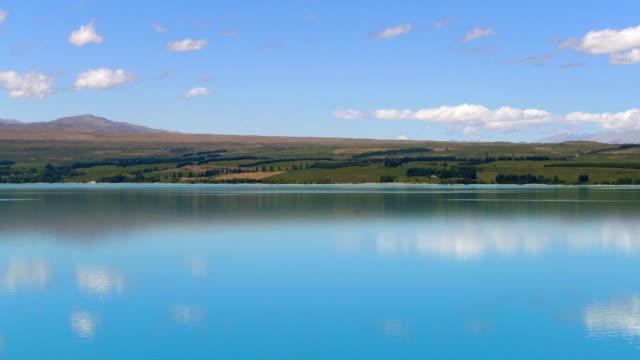 Lake landscape, clouds reflection on water at Lake Pukaki, New Zealand video