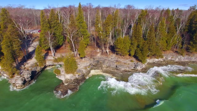 Lake Michigan waves crash on rocky shores of Cavepoint, Wisconsin video