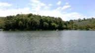 Lake resort with water bicycle on lake. video