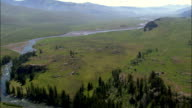 Lamar River Flowing Out Of Lamar Valley  - Aerial View - Wyoming, Park County, United States video