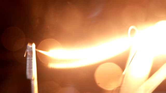 lamp is lit, filmed on a macro lens video