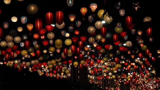 Lamps moving in the wind at night. video