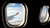 Land seen through the window of jet airplane. Airplane slowly landing video
