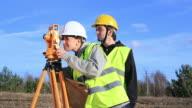 Land surveyors on construction site video