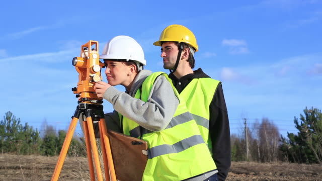 Land surveyors on construction site video