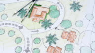 Landscape Architect Designs Blueprints For Resort. video