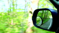 Landscape in the sideview mirror of a speeding car video
