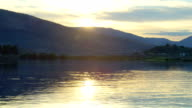 Landscape of lake with mountains at sunset video