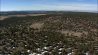 Landscape Of Trees And Patches Of Snow  - Aerial View - New Mexico,  Cibola County,  United States video