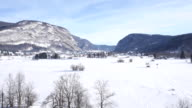AERIAL: Landscape with a lake covered in snow video