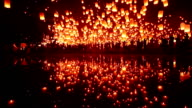 Lantern flying water reflection video