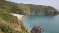 Lantic Bay Cornwall England uk secluded beach on summer day PAN video
