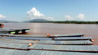 Laos and Chinese cargo boats in Mekong river video