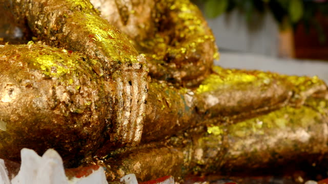 lap image of Buddha is decorated with gold leaf video