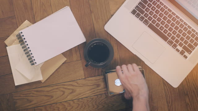 Laptop and Coffee with Office Supplies on Wood video
