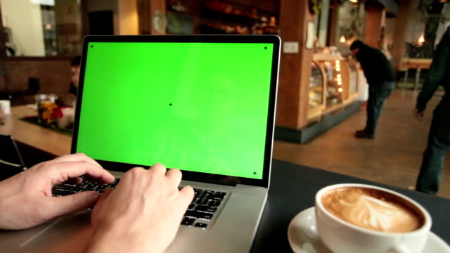 Laptop at a Cafe HD video