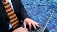 Laptop by the pool video