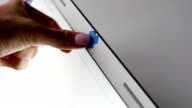 Laptop camera closed by blue tape, screen go dark video