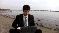 Laptop executive at the beach. video