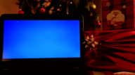 Laptop monitor with christmas decoration video