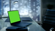 Laptop with Green Mock-up Screen Lies on a Table Modern Minimalist Office. video