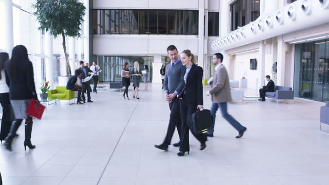 Large business crowd walking through offices video