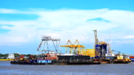 large cargo ship moored in midstream. Behind the shipping pier. video