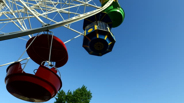 Large carousel at an amusement park. A great wheel turns slowly. video