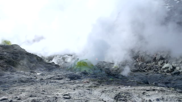 Large clouds of sulphur steam arise from multiple sulphur vents - Wide Shot video