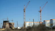Large construction cranes work on construction video