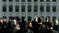 Large crowd of pedestrians walk over London Bridge video