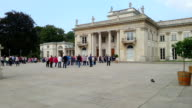 Large crowd of tourists walking in front of Lazienki Palace video