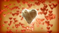 Large diamond heart among small red hearts, true love. video