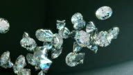 Large diamonds falling and rolling down over leather background video