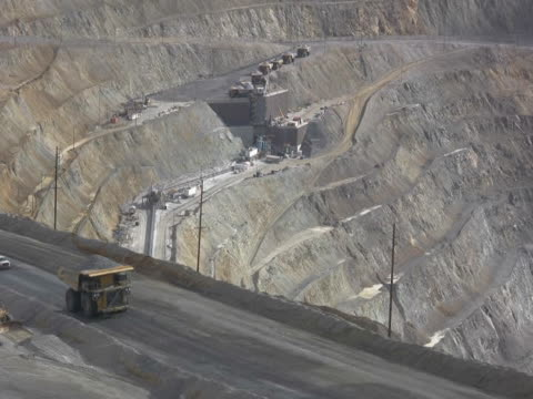 NTSC Large dump truck hauling iron ore in a mine video