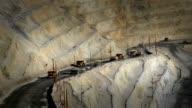 Large dumptrucks getting copper ore video