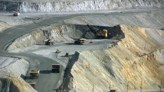 Large dumptrucks lining up to get copper ore video