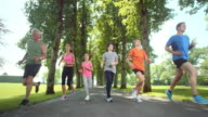 SLO MO TS Large family jogging in park video
